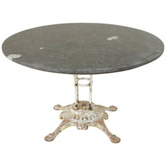 Large French Iron Garden Table with 49 Inch Diameter Blue Stone Top, circa 1900