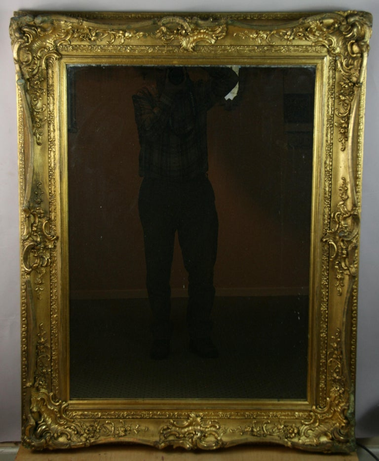 8-127 elaborately detailed wood carved and gesso mirror At one point mirror was replaced with new mirror.