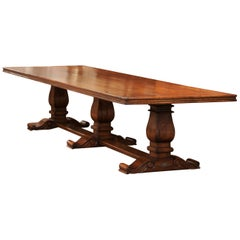 Large French Louis XIII Style Walnut Trestle Farm Table with Three Carved Legs