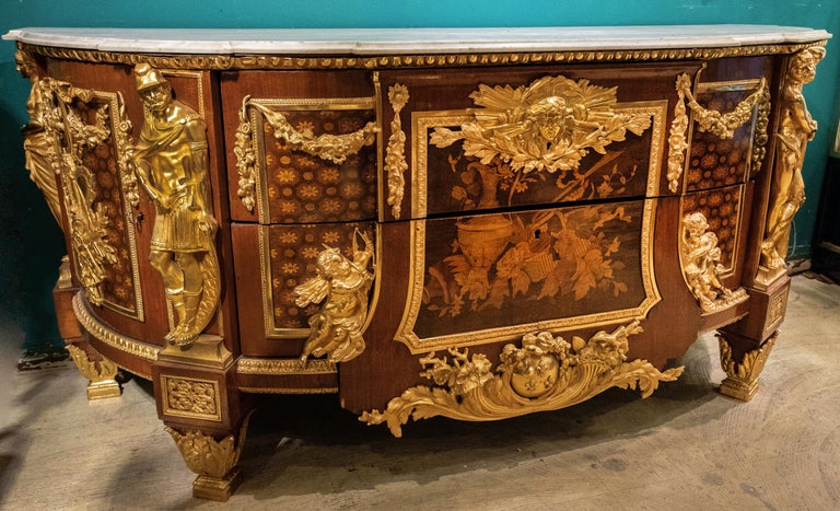 A fine and large French early 20th century Louis XVI style mahogany, kingwood and fruitwood marquetry armorial commode with sycamore marquetry and gilt bronze mounts, after a model of The Commode Commandée Pour La Chambre de Louis XVI à Versailles