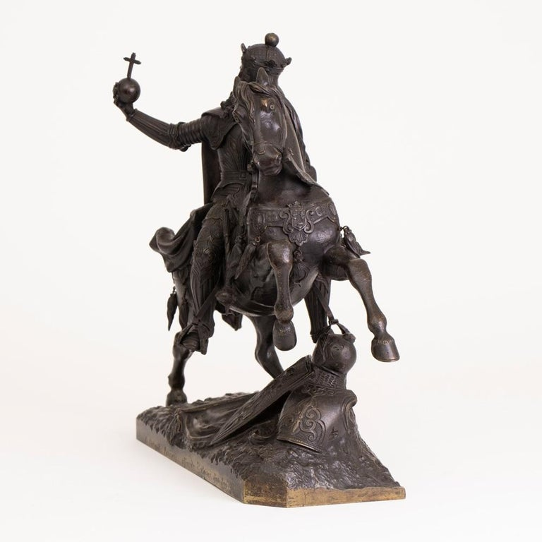 Large French mid-19th century bronze knight on horseback Circle of Jean-François Théodore Gechter (1796-1844), a French equestrian bronze of Charlemagne, mid-19th century, the King in full armour holding aloft an orb, the naturalistic base with