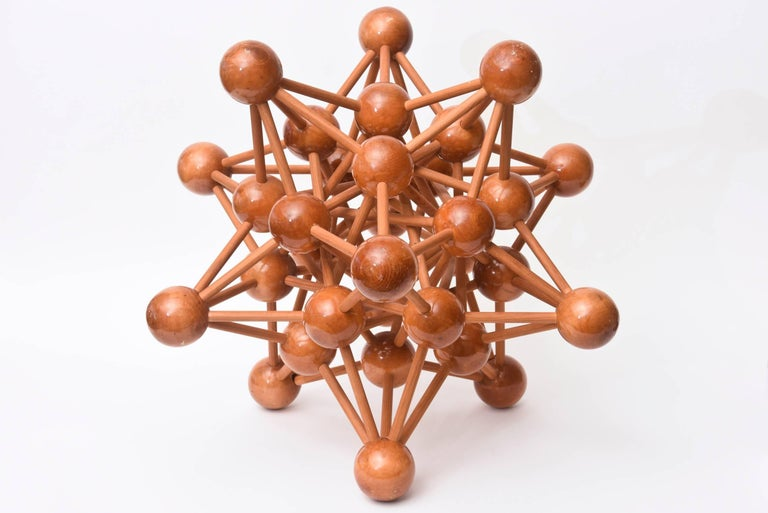 This amazing vintage French atomic wood sculpture is one the largest ones seen. It is Mid-Century Modern. It would be great on a pedestal or large cabinet and or console. It is quite intricate. This may have been at the worlds fair exhibition in