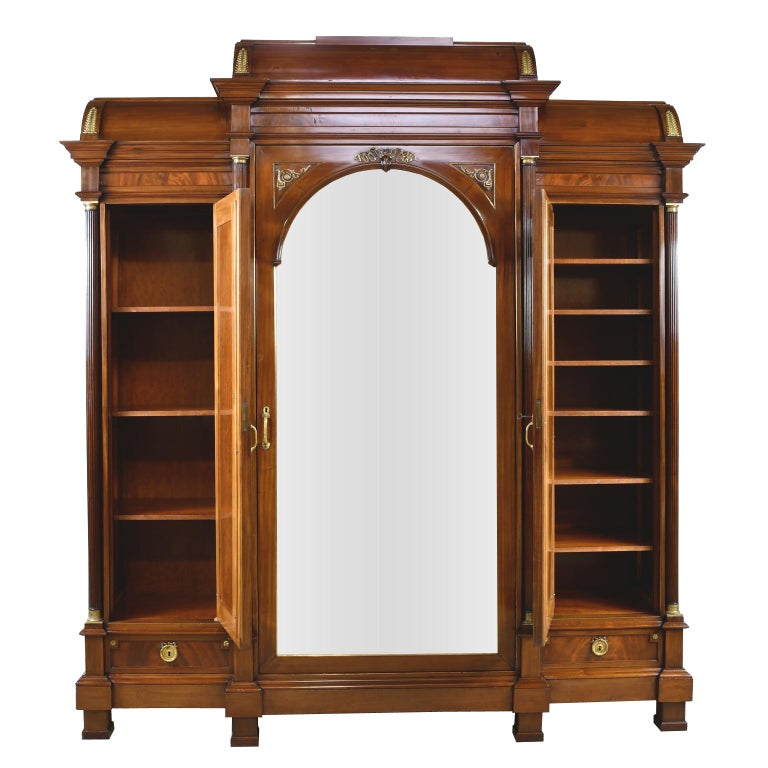 A sophisticated and grand French Napoleon III second Empire armoire in mahogany with fine bronze doré ormolu mounts, and three beveled, mirrored doors. France, circa 1870-1890. This very impressive armoire displays an extremely high level of