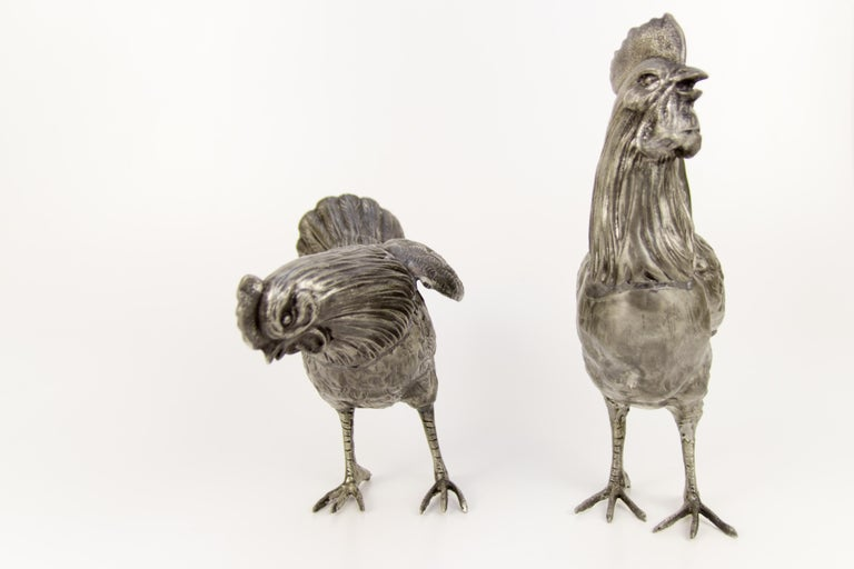 Adorable pair - vintage rooster and chicken sculptures / figures made of pewter in France in the middle of 20th century. Dimensions:  Rooster: Height 31 cm / 12.2 in; width 25.5 cm / 10.03 in; depth 8 cm / 3.15 in. Chicken: Height 22.5 cm /