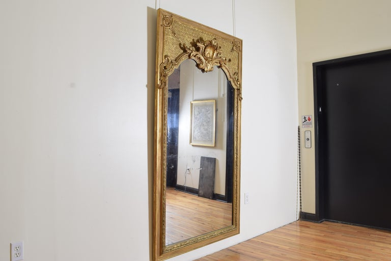 Louis XIV Large French Regence Style Carved Giltwood and Gilt-Gesso Mirror, 3rdq 19th cen. For Sale
