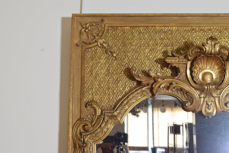 Late 19th Century Large French Regence Style Carved Giltwood and Gilt-Gesso Mirror, 3rdq 19th cen. For Sale