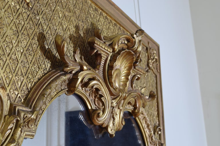 Large French Regence Style Carved Giltwood and Gilt-Gesso Mirror, 3rdq 19th cen. For Sale 1