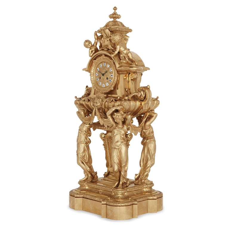 This gilt bronze (ormolu) mantel clock—which measures an impressive 91cm (36 inches) in height—is a magnificent piece of design. The clock was crafted in France when Louis Napoleon Bonaparte (Napoleon III) was Emperor of France (from 1852-1870). The
