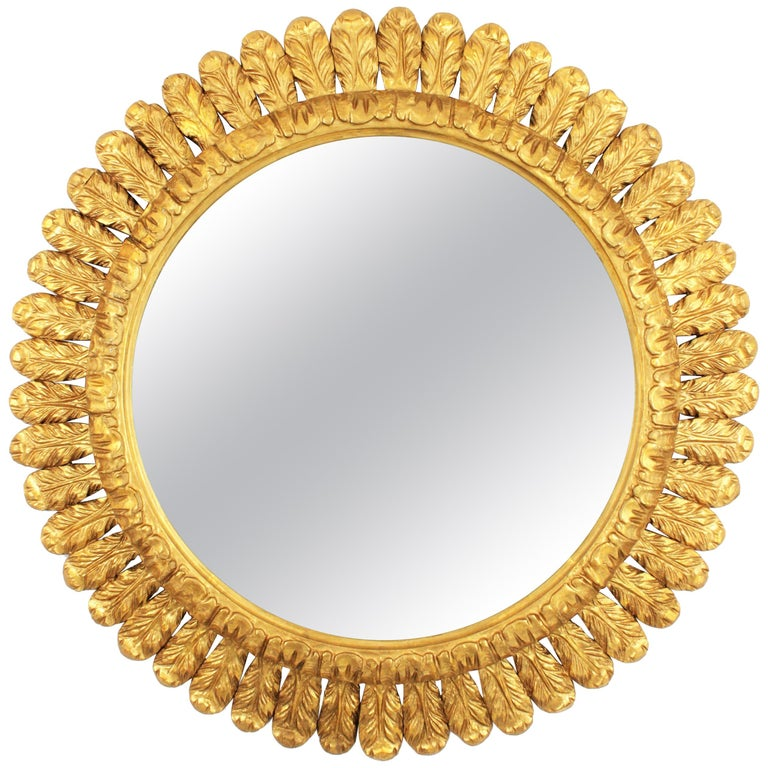 Gorgeous hand carved French sunburst mirror with a frame richly decorated by waterleaves and gold leaf gilt. France, 1950s. Interesting to highlight a main room, a bathroom or an entry hall. It has its original gilt and a magnificent