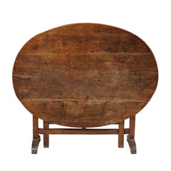 Large French Tilt-Top Oval Shaped Wine Tasting Table from the 19th Century