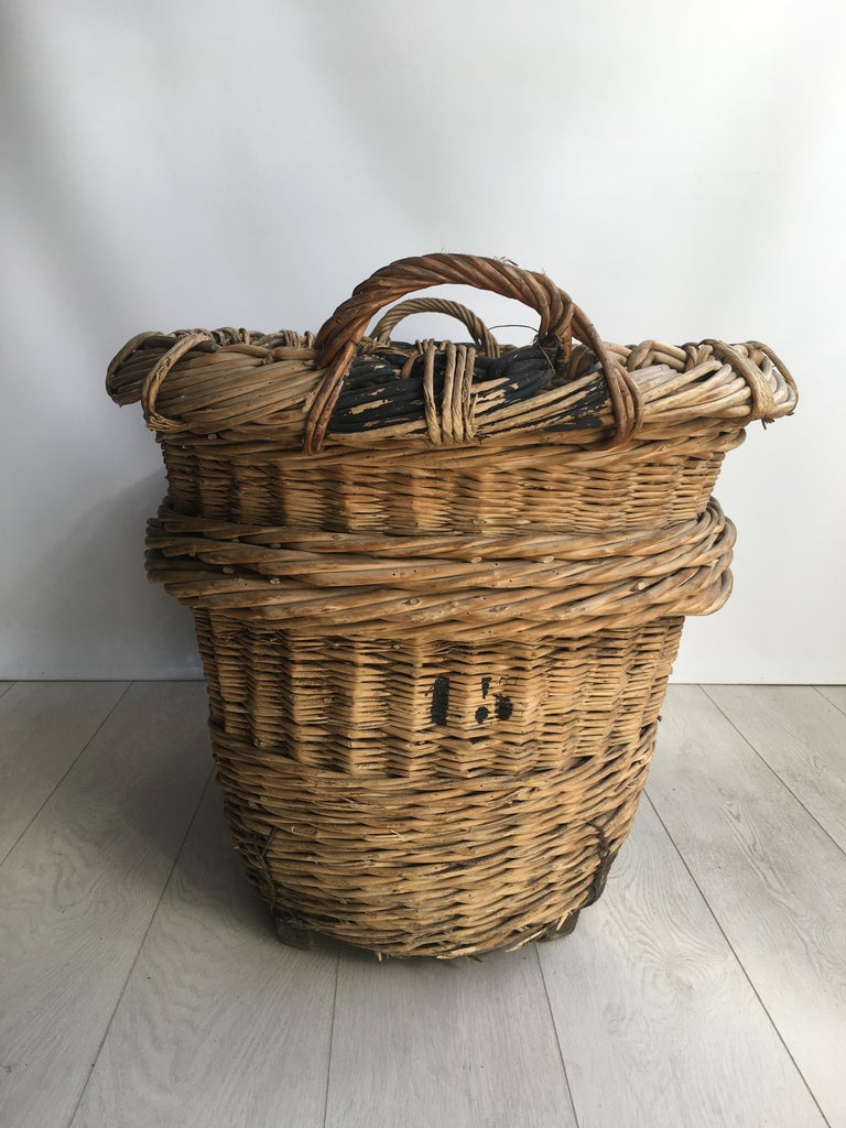 Beautiful heavy duty wicker baskets from the vineyards of Champagne region in France   Lovely decorative baskets bound on wooden feet, very sturdy (some old woodworm holes, the entire basket has been treated)  Perfect fireside as a log/blanket