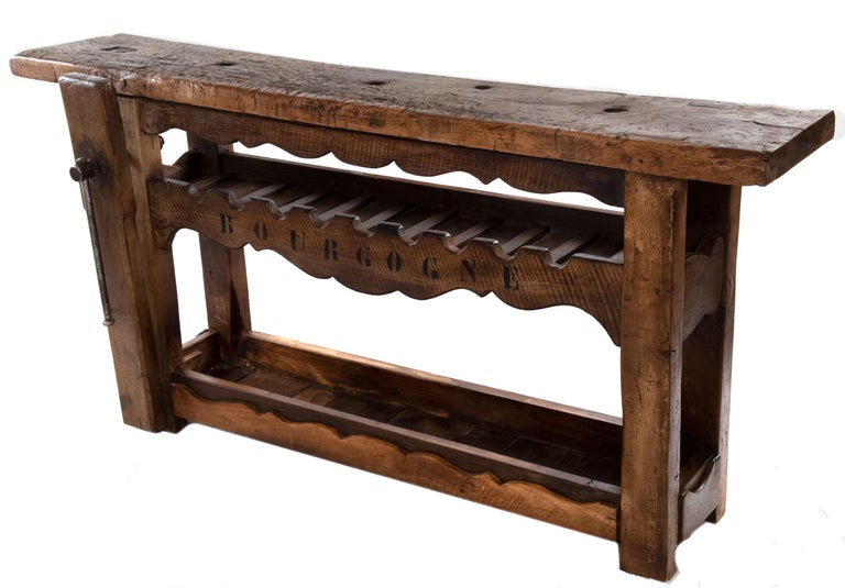 Made from 19th century French walnut, each bench dates to the 1870s in Lyon. Each bench bears the marks of generations of use. A small furniture maker in Lyon has recently acquired a limited number of these traditional benches, side-tables, and