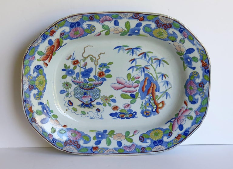 This a large, early 19th century serving dish of 14.5 inch width made by Mason's Ironstone in the Bamboo and Basket chinoiserie pattern, dating to the English Georgian period, Circa 1815.  Very early 19th century Mason's Ironstone Serving Dishes