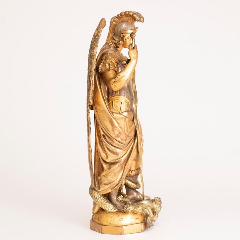 Large gilded ecclesiastical statue of Saint Michael  Very good quality original water gilding which we have not touched. There are some minor areas of damage to the gilding ,however no damage to the actual wood carvings or the main body of the