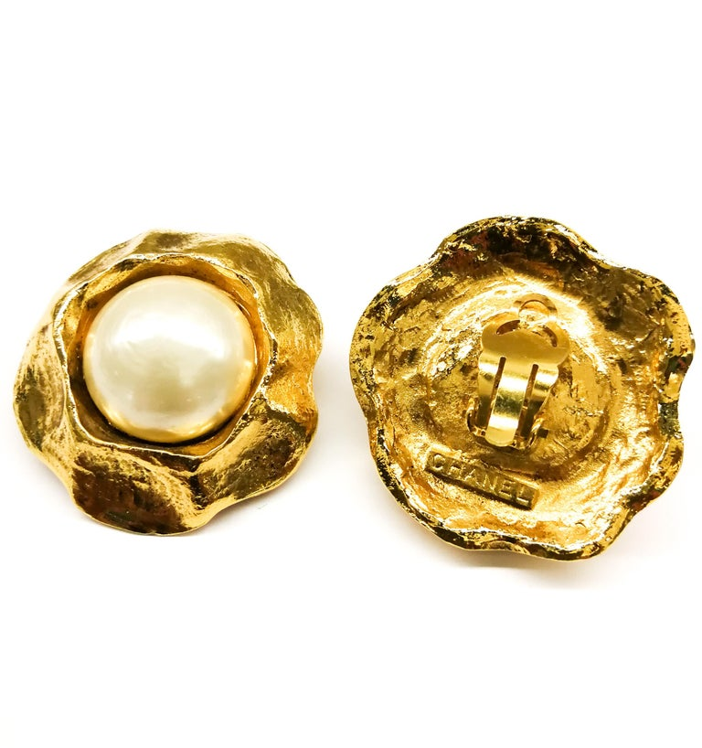 Classic pearl and gilt earrings , designed by Victoire de Castellane for Chanel, with a wide gilt 'thumb indented' border, in which is nestled a larger baroque pearl cabuchon. Very smart, a prime example of Castellane's oeuvre at Chanel at this time