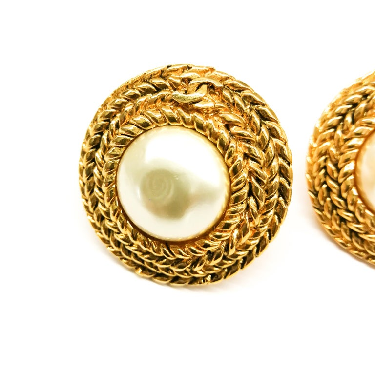 Classic pearl and gilt earrings , designed by Victoire de Castellane for Chanel, with a plaited gilt braid encircling the baroque pearl, with the iconic 'CC' motif interwoven. Smart, timeless and ulitmately wearable! Not much needs to be said about
