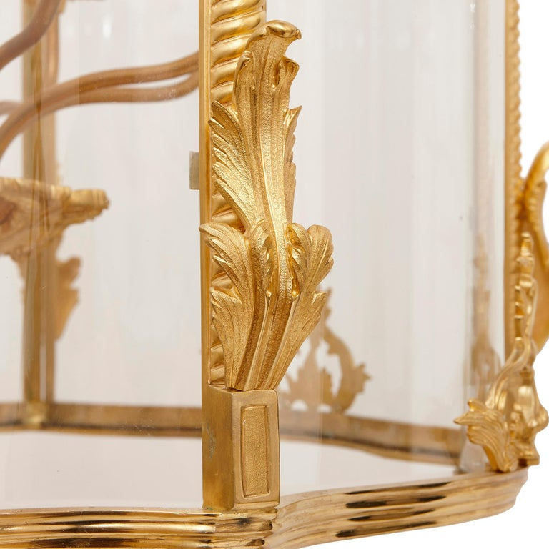 This hall lantern has been exquisitely crafted from glass and gilt bronze (ormolu). The piece will look wonderful placed in a grand entrance hall, living or dining room. The light it produces will reflect of its lustrous gold surfaces, causing the