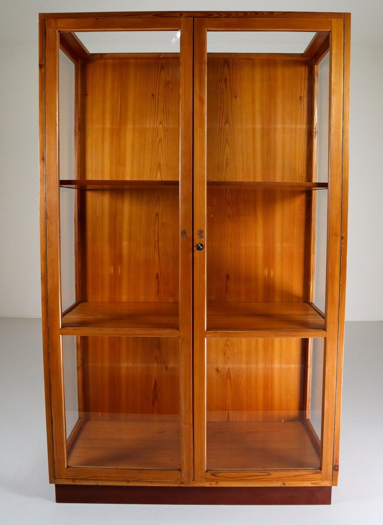 Large glazed display cabinet with perfect patina and original glass made in Praque Czech Republic 1950s for the National U P Museum Praha in solid Pine .The wooden shelves can be height adjusted. Pieces like this with original patina and glass are