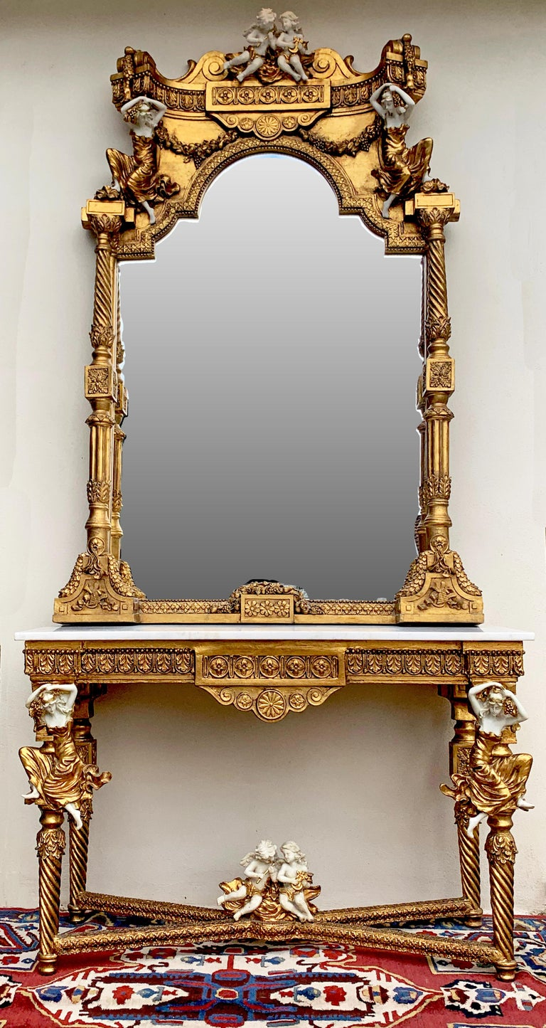 Beautiful and ornate solid wood mirror with cast stone angels and figures on both mirror and matching console table. Console table top is a white marble (slight scratches). Very elegant and luxuriously worked piece, made in Europe. (probably