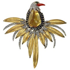Large Gold dramatic bird Brooch with Coral Diamonds Emeralds and Sapphires