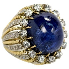 Large Gold Ring Centered around a Cabochon Tanzanite with Diamonds