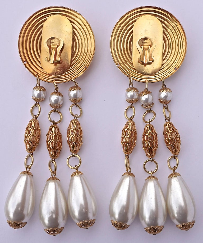 Large gold tone faux pearl chandelier vintage clip on statement gold tone clip on chandelier earrings featuring a circular ridged top and a trio aloadofball Image collections