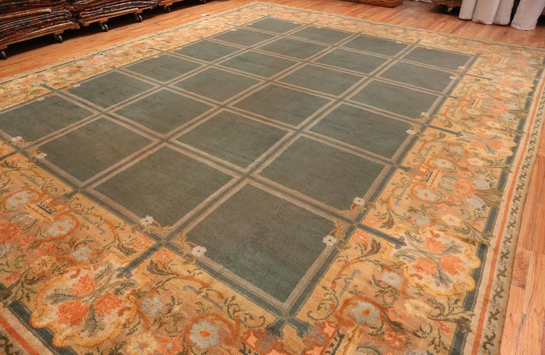 A breathtaking floral and grid design large size green background color antique Spanish Savonnerie carpet, country of origin / rug type: Antique Spanish rugs, circa early 20th century. Size: 15 ft 6 in x 19 ft (4.72 m x 5.79 m)  This magnificent