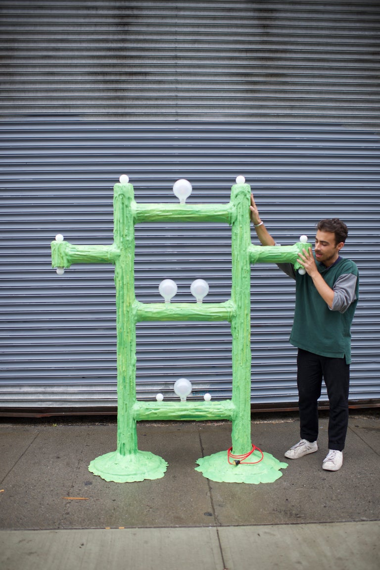 This large piece is one of a kind and was made for a solo show in 2018. It has two weighted bases and the signature pooling effect of all of Joseph Algieri's lamps. The color resembles a bright green. Comes wit a 6' cord.