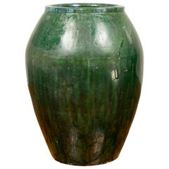 Large Green Glazed Ceramic Jar from the Early 20th Century with Tapering Body