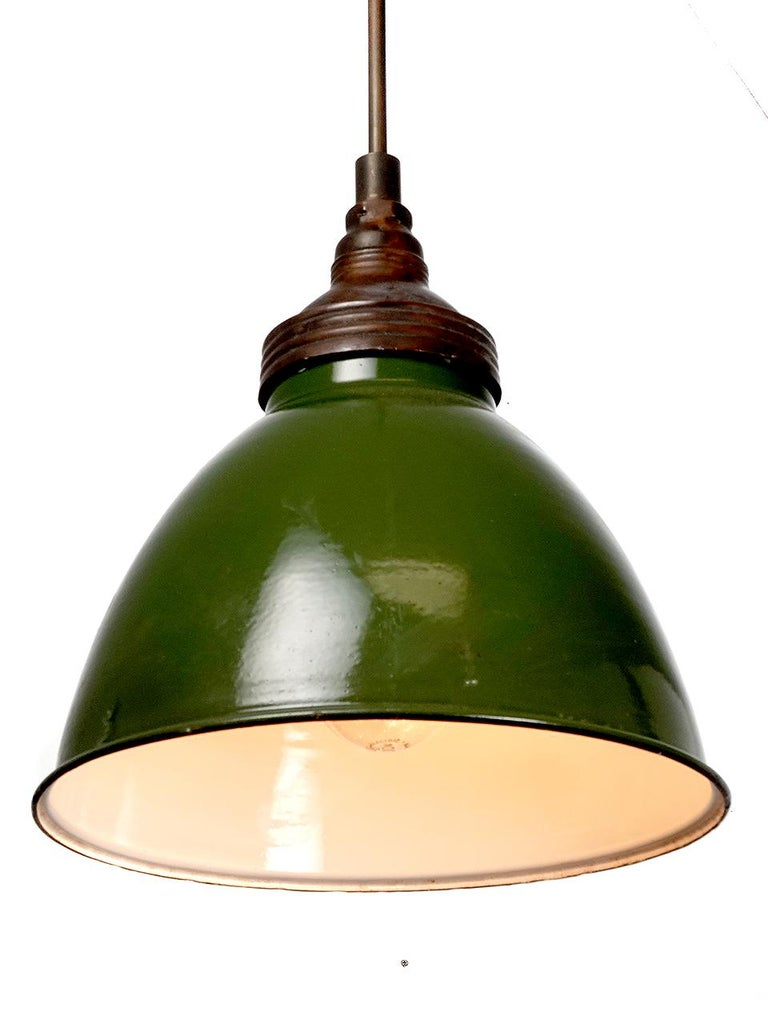 These and early simple large dome still feel contemporary after 75 years. The shade has a baked on finish with a small age or wear mark here and here. The top is dark copper and finish gives the dome its unique look. We have a few in stock and they