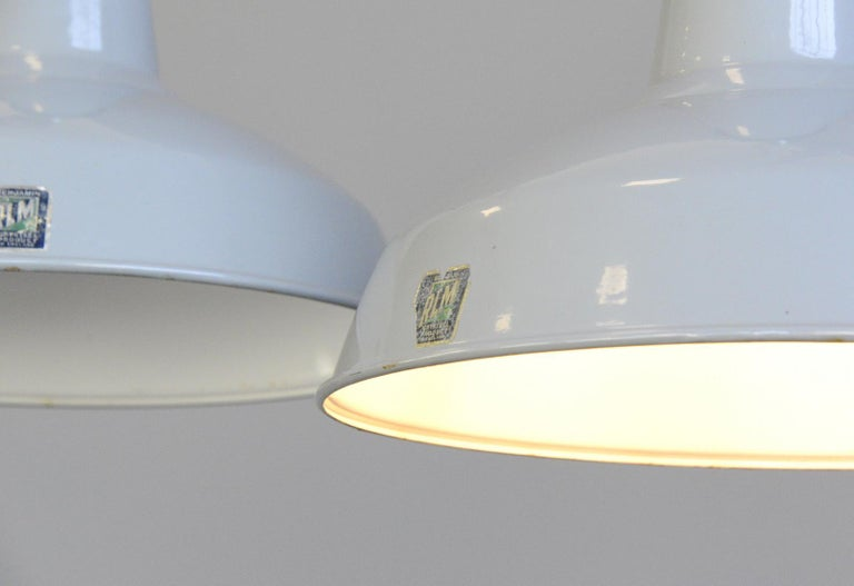 Large grey enamel factory lights by Benjamin, circa 1950s  - Price is per light (14 available) - Vitreous grey enamel - White enamel inner reflectors - Comes with 100cm of gold twist cable - Comes with 100cm of steel suspension chain - Comes with