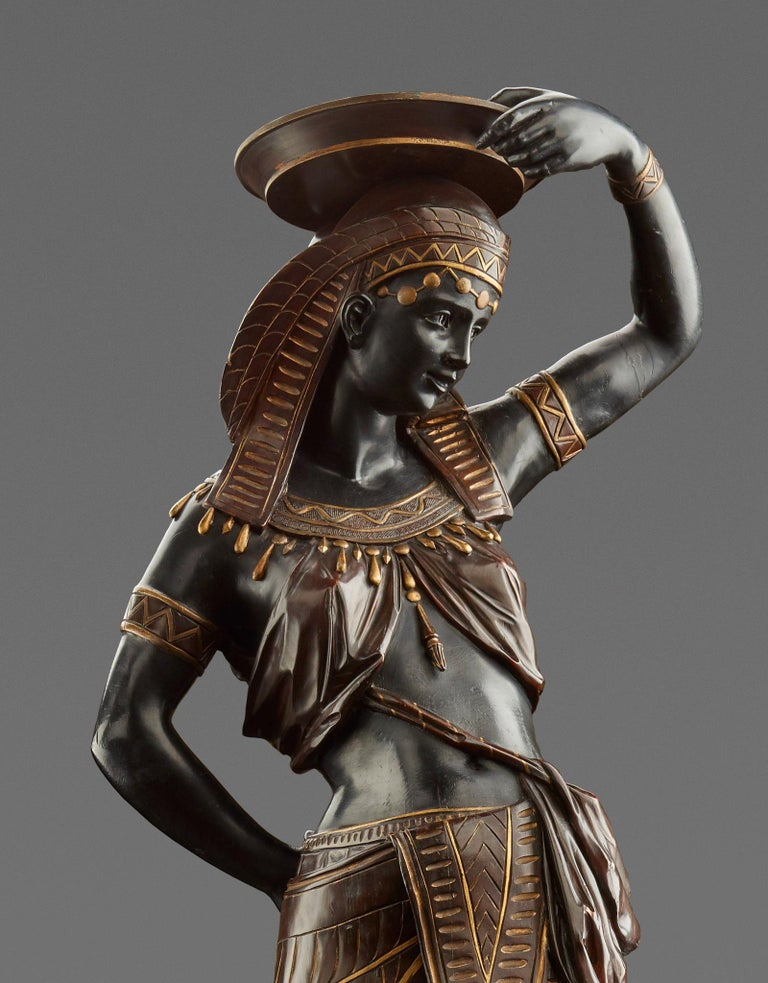 Venice, c. 1865 Wood, carved and set, partially gilded. On a pedestal decorated with lancet leaves and a surrounding animal frieze with four kneeling servants, the impressive figure of a graceful, richly decorated Egyptian dancer, carrying a bowl