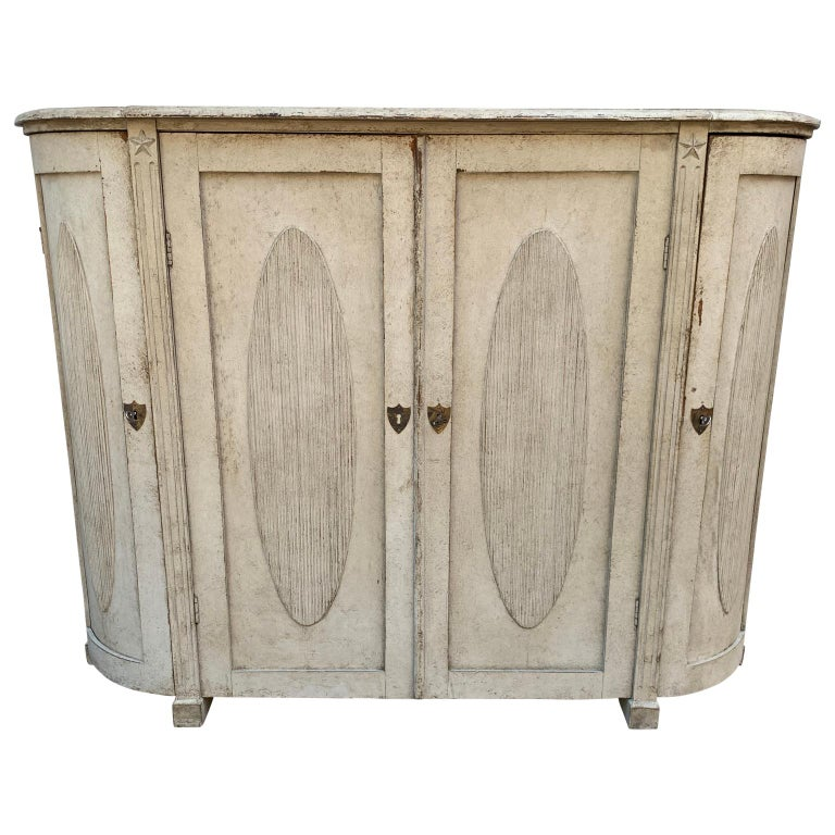 Large Curved 4 Door Gustavian Sideboard. The sideboard is carved and with a gray painted wood finish.  NB: EUR250 front door delivery to most areas of London-Brussels-Amsterdam-Hamburg-Copenhagen and Stockholm corridor.