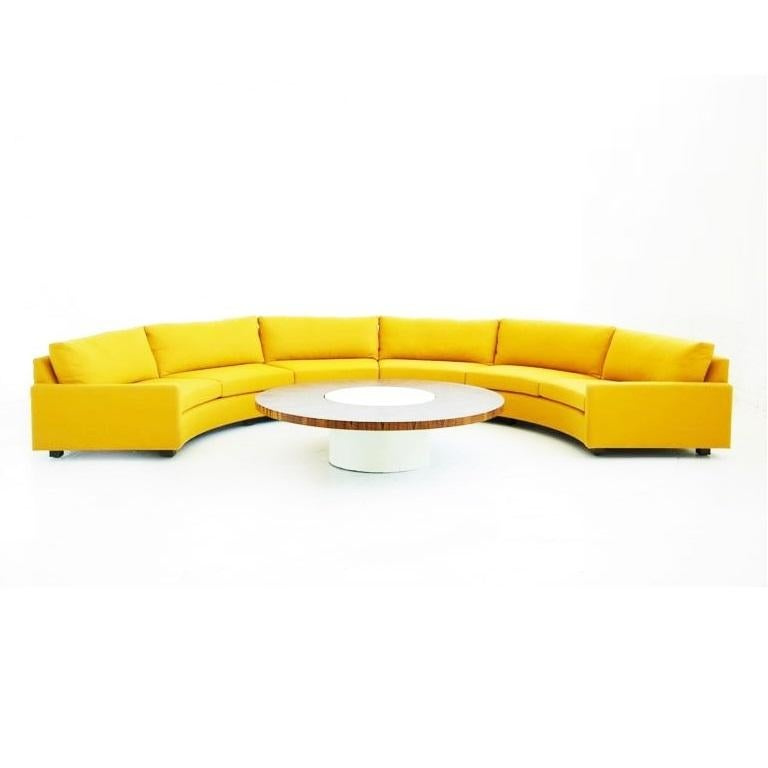 Clean, Minimalist two-piece semi circular sofa, model no 825 designed by Milo Baughman for Thayer Coggin, circa 1968. Comfortable deep seats and low slung profile. Newly upholstered in a yellow fabric with loose back and seat cushions resting on