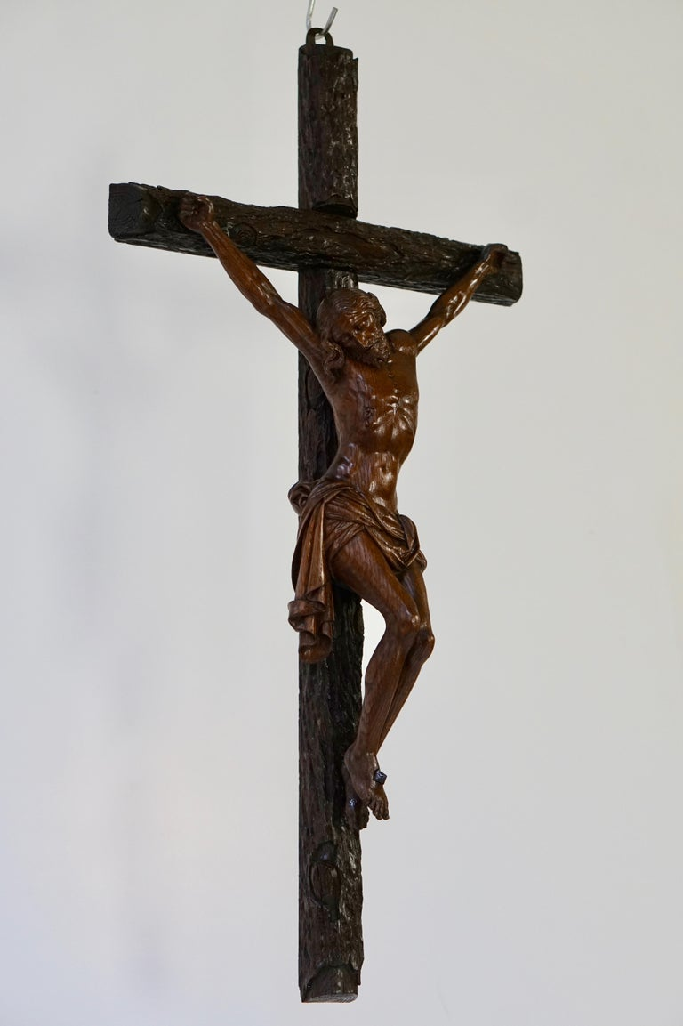 One of a kind, large crucifix with an amazing patina. This remarkable and size able corpus of a suffering Christ on the cross is different to almost all others. Measures: Height 76 cm. Width 40 cm. Depth 12 cm.