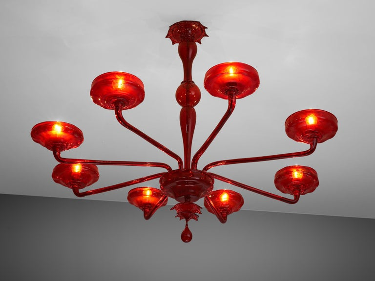 Hand blown chandelier, Murano glass, Italy, 1960s  1960s Venetian chandelier composed of ruby red Murano glass. Handcrafted and executed with modern lines in combination with the eleganceof Venetian traditions. The eight long arms, each holdinga