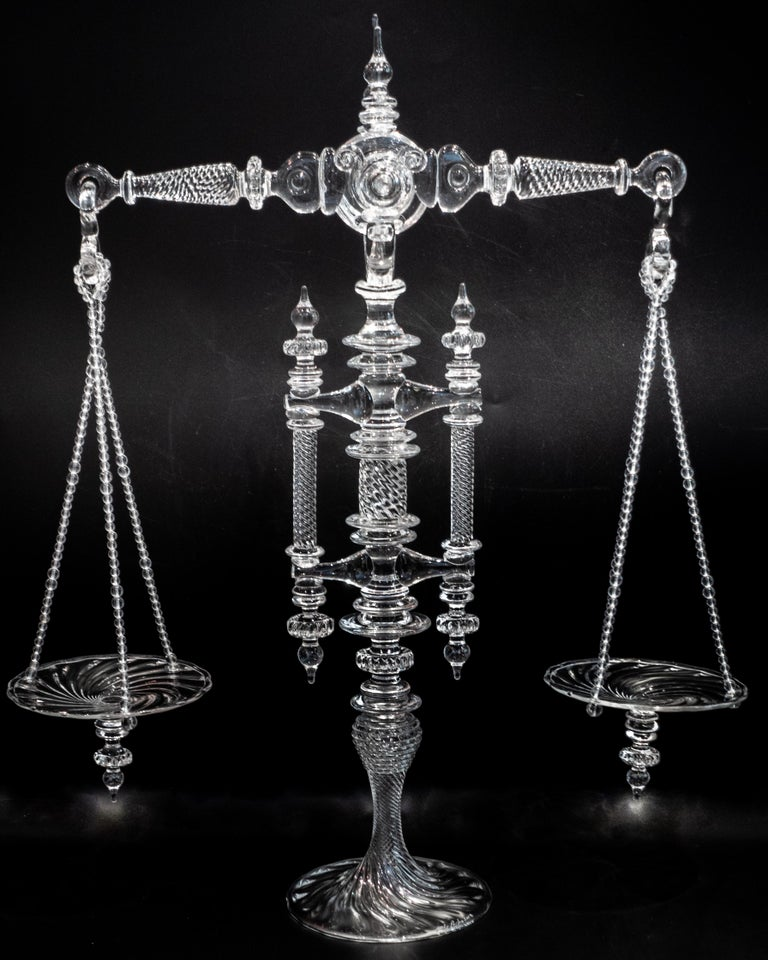 Hand blown glass balance scale by Andy Paiko. The balance is accurate to within one gram. Part of a very limited series, each instrument varies significantly in detail and complexity, making each one unique.  Artist Andy Paiko works to examine the