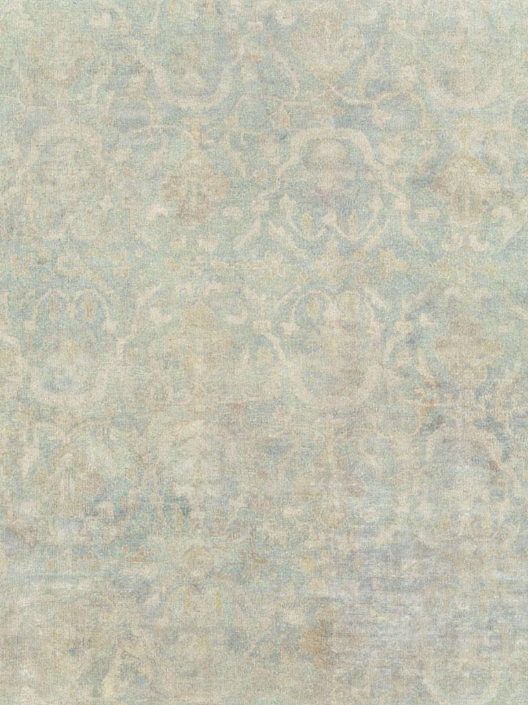 An antique Chinese handmade rug from the early 20th century in shades of seafoam blue and seafoam green.  Measures: 10' 1