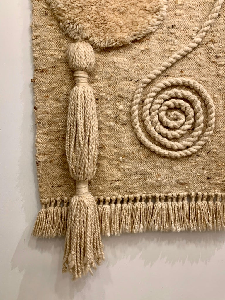 This is an outstanding handwoven wool art piece with extraordinary details and textures in 100% wool (earth tones). This oversized piece is mounted on a custom designed metal bracket with brushed brass knobs (see detail images).  Extremely well