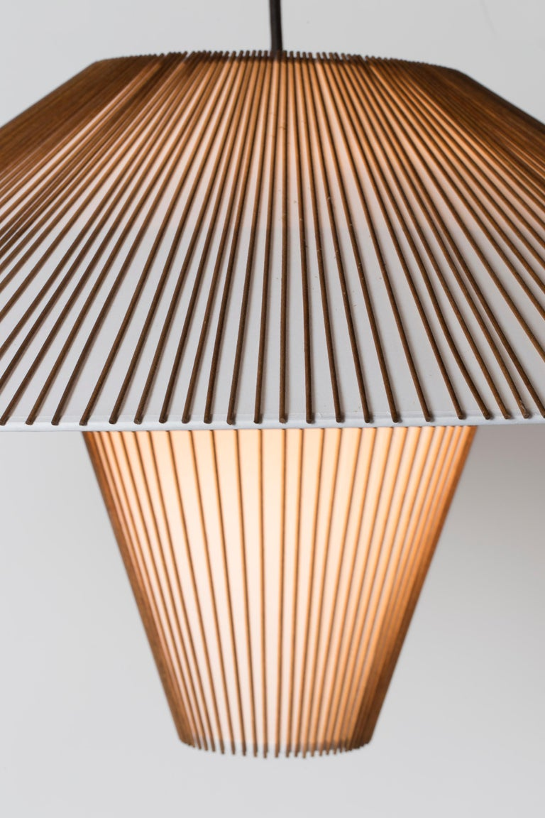 The large hanging pendant is part of the re-issued Smilow Lighting Collection, originally designed by Mel Smilow in 1956 and officially reintroduced by his daughter Judy Smilow in 2017. This collection's sculptural and nature-inspired pieces bring a