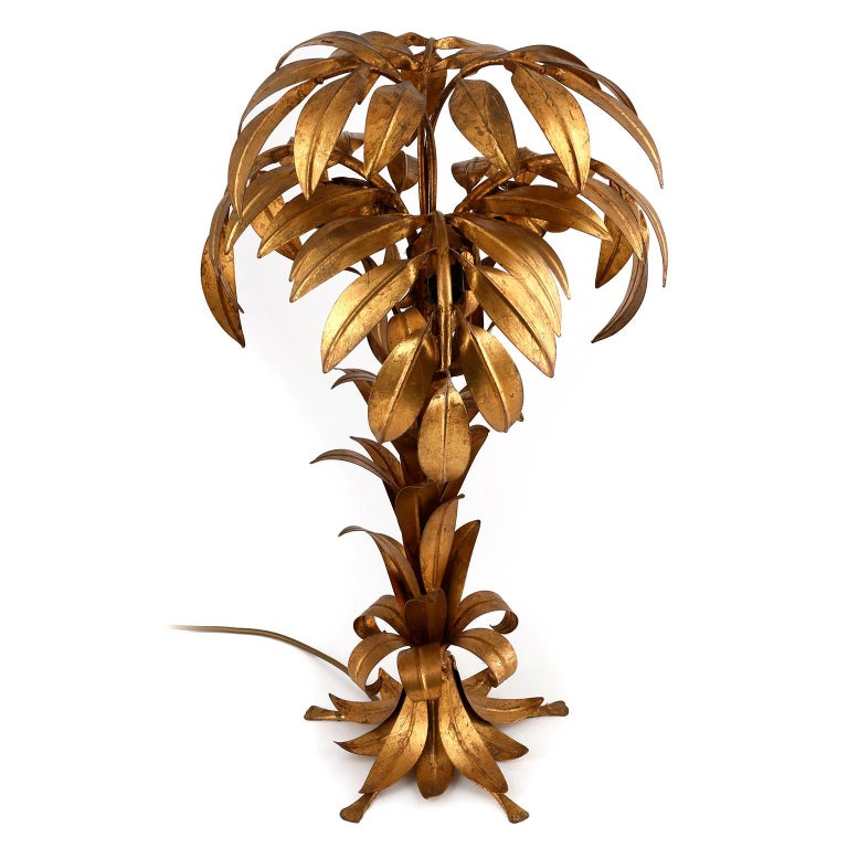 A Hollywood Regency table lamp by Hans Kögl (Koegl or Kogl), Germany, manufactured in midcentury, circa 1970.