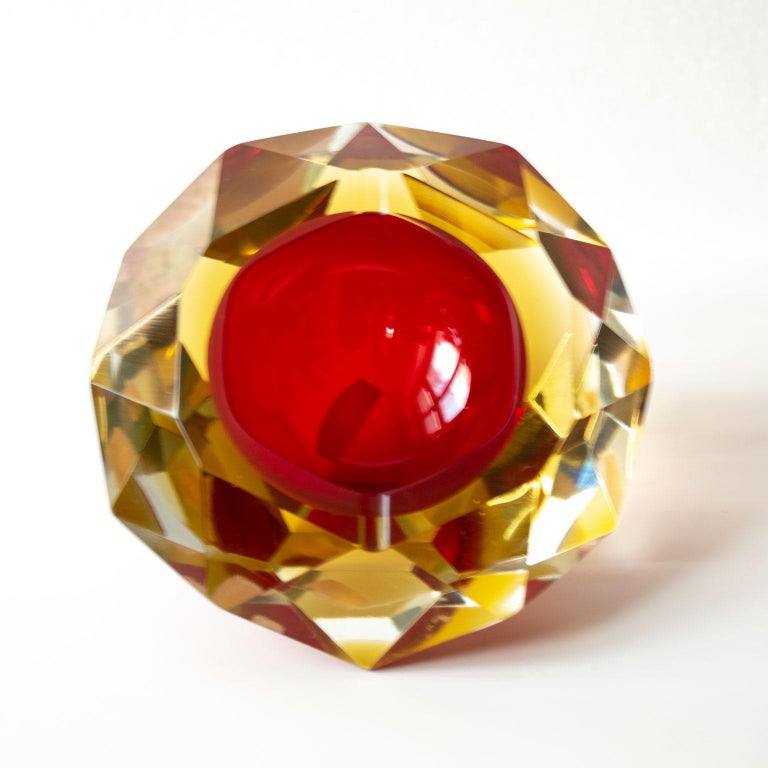 Cool and beautiful multifaceted Murano Glass ashtray by Flavio Poli.  He was born in 1900 in Chioggia, Italy, Poli and received his formal training at the Istituto d'Arte di Venezia. In the late 1930s, he became the artistic director and principal
