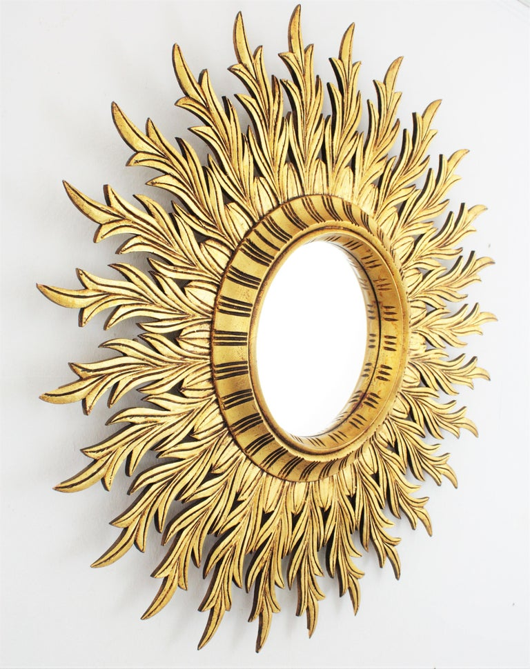 Spanish Large Hollywood Regency Carved Giltwood Round Sunburst Mirror, Spain, 1960s For Sale