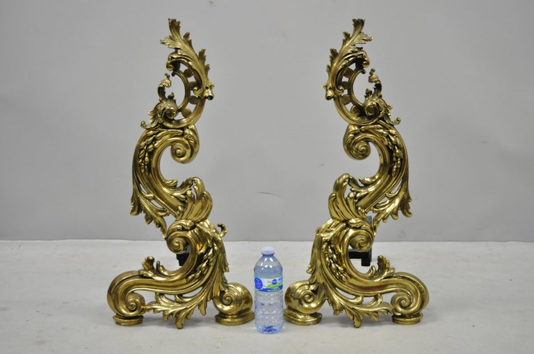 Large impressive antique French Rococo Baroque style acanthus scroll andirons. Items feature large impressive size, brass scrolling acanthus forms, cast iron supports, great style and form, circa early 20th century. Measurements: 27.5