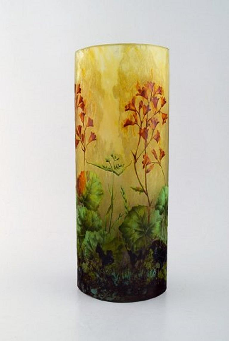 Large and impressive Daum Nancy Art Nouveau vase in mouth-blown enameled art glass. Acid-etched glass. Hand painted red flowers and branches in relief, late 19th century. In very good condition. Measures: 30 x 11.5 cm. Signed with Lorraine