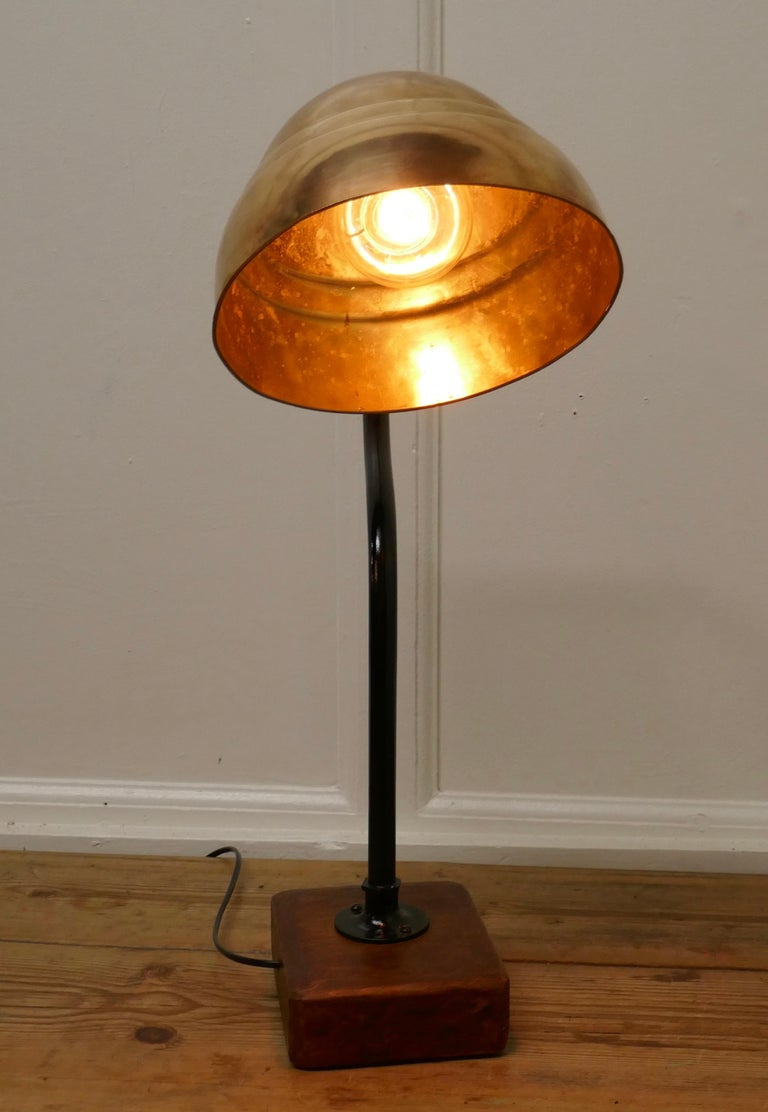 """Large industrial look desk lamp  A great piece the large shade has been cleaned back to the brass which gives a great reflective quality, the Brass swan neck support is painted in black and set in a chinky oak base  The light is 25"""" tall, 18"""""""