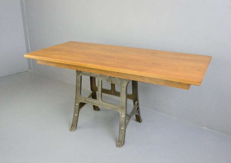 Large industrial table by Woods & Co Circa 1910.  - Cast iron base - Solid oak top - English ~ 1910 - Measures: 98cm tall x 90cm deep x 200cm long.