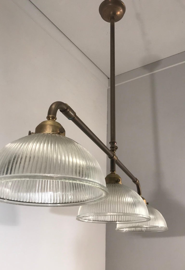 Large Industrial Three-Light Holophane Glass Style Chandelier with Brass Rods For Sale 5