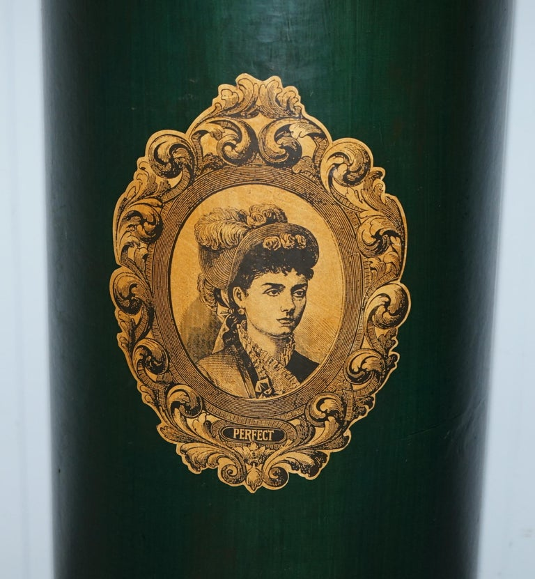 We are delighted to offer for sale this lovely handmade in Ireland green pedestal stand with Victorian lady picture  A good looking and decorative piece, I have no idea how old it is, I assume it was made for a shop or exhibition display  Its