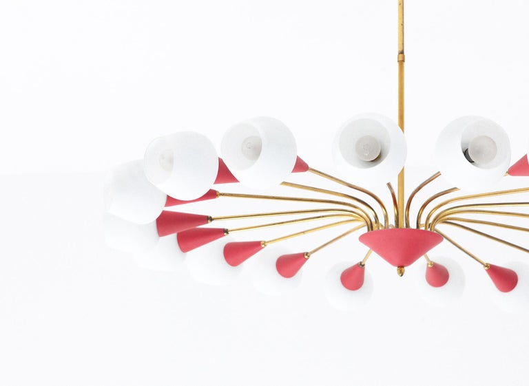 A very large eighteen-arm spider ceiling mount chandelier A Mid-Century Modern pendant lamp manufactured in Italy in the 1950s. Made of brass, light red painted metal and white opal glass lamp shades.  Original working wire, you can request to